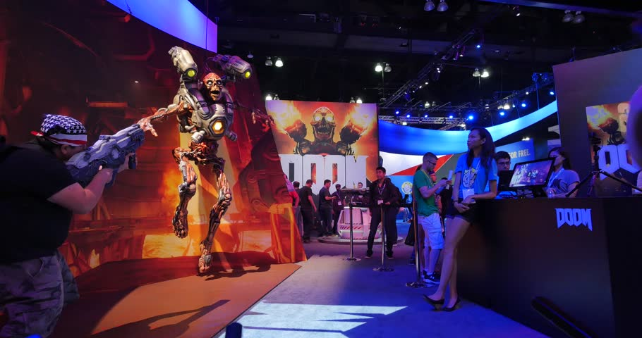 LOS ANGELES - June 17, 2015: Doom game booth at the E3 2015 expo in Convention Center. Electronic Entertainment Expo, commonly known as E3, is an annual trade fair for the video game industry. 4K UHD. - 4K stock video clip
