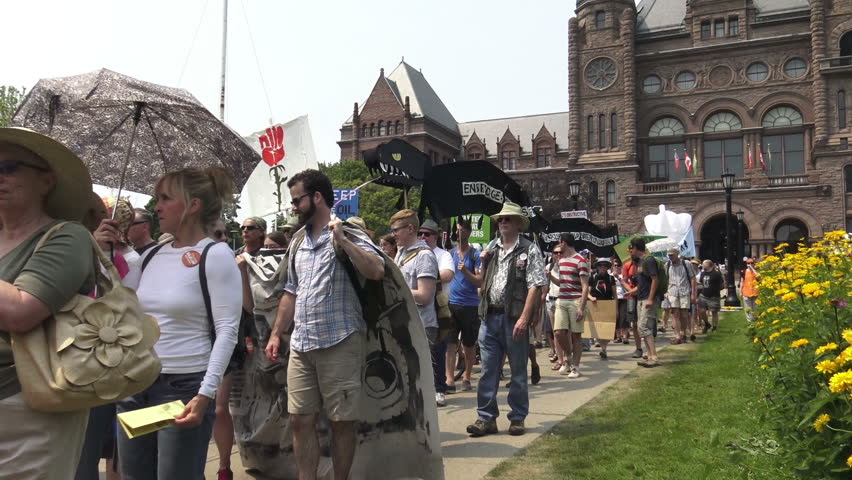 TORONTO - JULY 5: Thousands of people gather at Queen's Park and march through downtown  Toronto on Sunday's  March for Jobs, Justice and the Climate on July 5, 2015 in Toronto, Ontario, Canada.