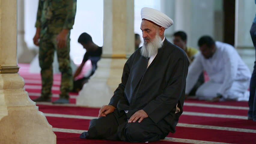 BAGHDAD, IRAQ - MAY 2015: Sunni cleric prays at Ibn Taymiyyah mosque (formerly Umm al-Tubul). This mosque witnessed clashes against US army during their presence in Iraq