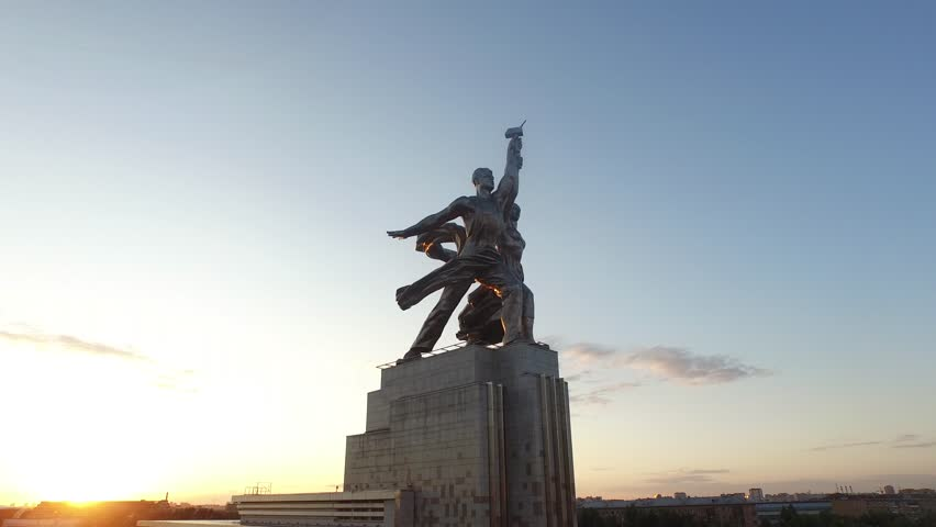 RUSSIA. MOSCOW. JULY 2015: Rabochiy i Kolkhoznitsa (Worker and Kolkhoz Woman) by sculptor Vera Mukhina. Sunset time. HELICOPTER VIEW 1 - 4K stock video clip