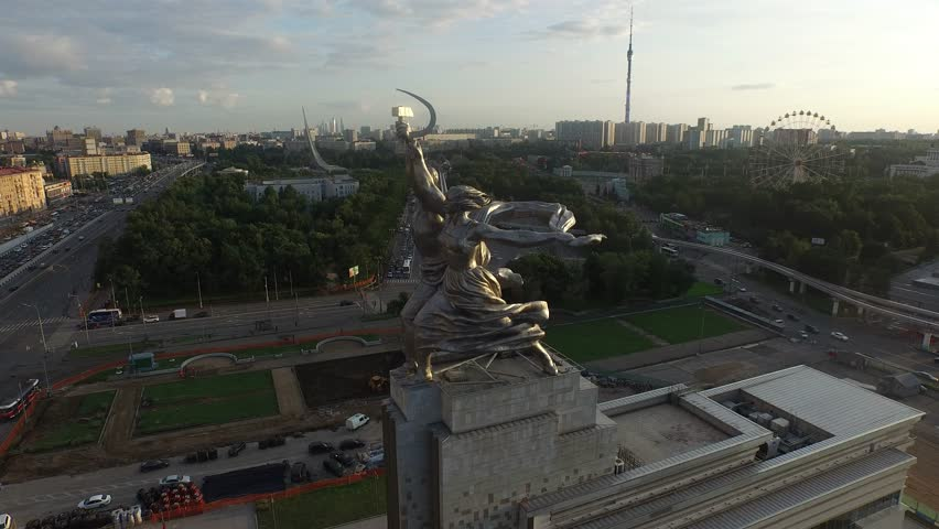 RUSSIA. MOSCOW. JULY 2015: Rabochiy i Kolkhoznitsa (Worker and Kolkhoz Woman) by sculptor Vera Mukhina. Sunset time. HELICOPTER VIEW 5 - 4K stock footage clip