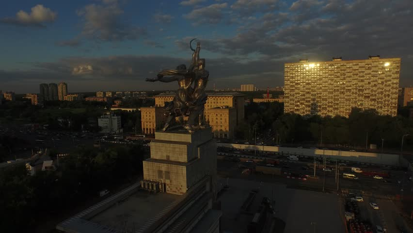 RUSSIA. MOSCOW. VDNkH. JULY 2015: Rabochiy i Kolkhoznitsa (Worker and Kolkhoz Woman) by sculptor Vera Mukhina. Sunset time. HELICOPTER VIEW 6 - 4K stock footage clip