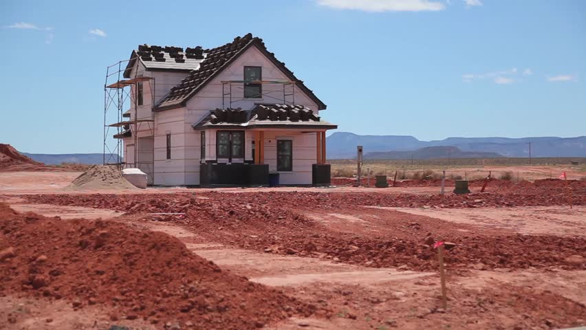 A home under construction in the isolation of the utah for Building a house in utah