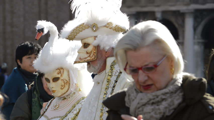 Venice, Italy - february 2015 - Carnival of Venice - during the Carnival, costumed actors cross St Mark's square. White winged angel dress is the main attraction for public