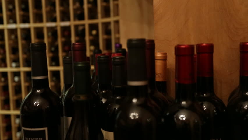 Wine bottles on a rack tracking shot - HD stock video clip