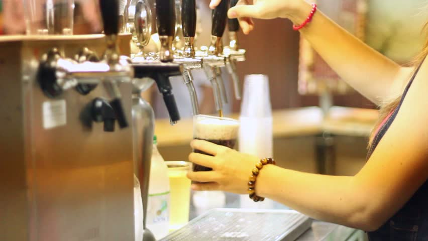 Pouring a beer at a local feast - HD stock footage clip