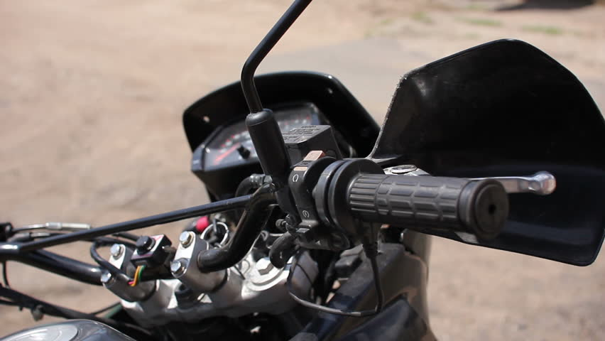 female hand turning on motorbike - HD stock footage clip