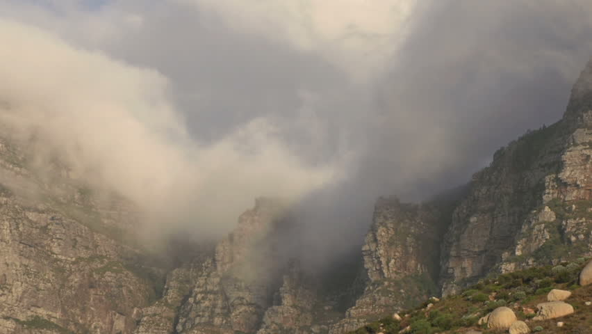 Zoom out of clouds rolling over 12 Apostle mountains, Cape Town,South Africa | Shutterstock HD Video #10839278