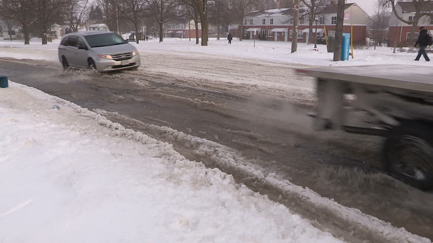 Waterloo, Ontario, Canada March 2015 Puddles snow  and slush in spring melt - HD stock video clip