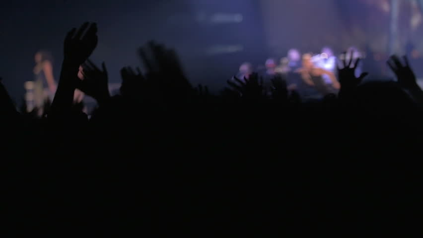 Slow motion of people on rock or pop concert waving hands to the favorite music rhythms, singer performing on the stage | Shutterstock HD Video #10877600