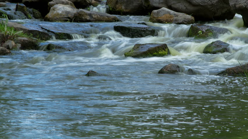 forest stream time lapse, Stream Water and Green Mossy Rocks, mountain stream time lapse 4K, Moss On The Rocks Forest Stream, Forest river, Granite boulders with river - 4K stock footage clip