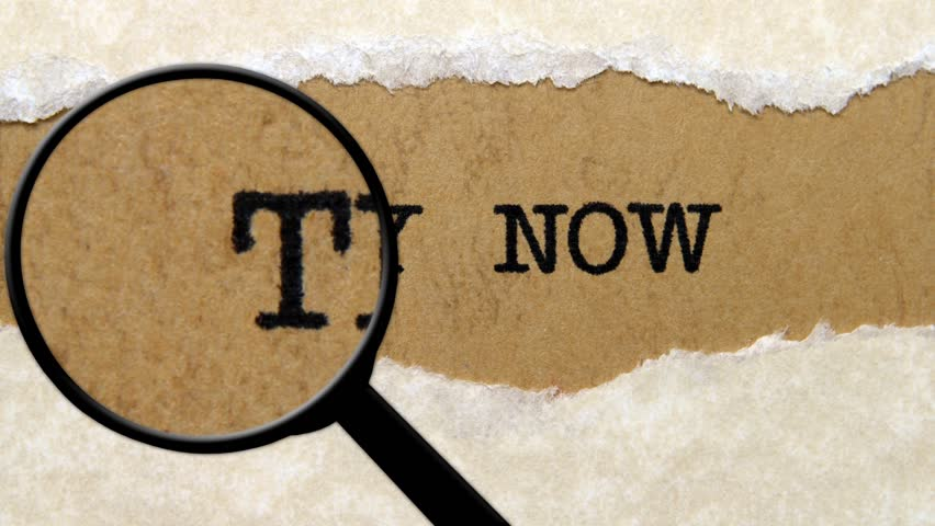 Magnifying glass on try now text