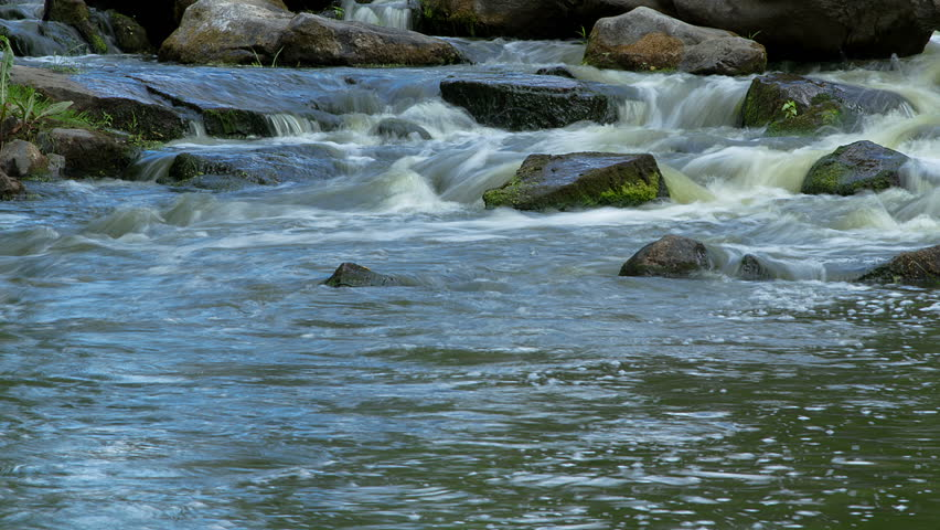 forest stream time lapse, mountain stream time lapse, Moss On The Rocks Forest Stream, Forest river, Water runs quickly through the rapids, Granite boulders with river - HD stock footage clip