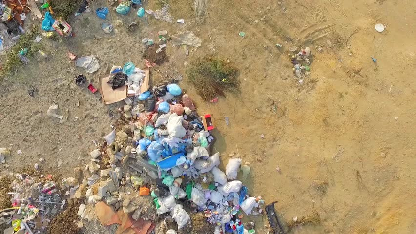 AERIAL VIEW. The camera flies over a pile of waste. Problems associated with garbage collection in the suburbs of the city. Cleaning nobody does.