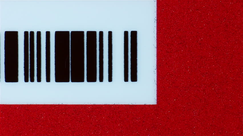 Dolly shot of business card with bar code, Macro