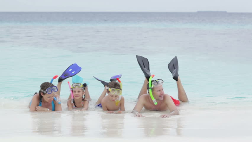 family with kids and snorkeling gear