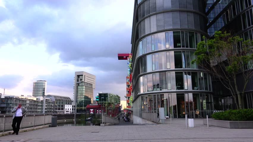 DUSSELDORF, GERMANY - May 8: Dusseldorf Harbor is home to some spectacular postmodern architecture, with contemporary status symbols signifying corporate success: Frank Gehry.,May 8, 2015,ULTRA HD 4K - 4K stock footage clip