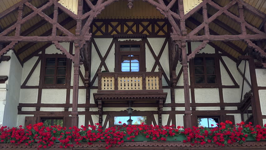 INNSBRUCK, AUSTRIA - SEPT 2014: Innsbruck Austria cultural wooden home with flowers. Internationally winter sports center, hosted 1964 and 1976 Winter Olympics and 1984 and 1988 Winter Paralympics.