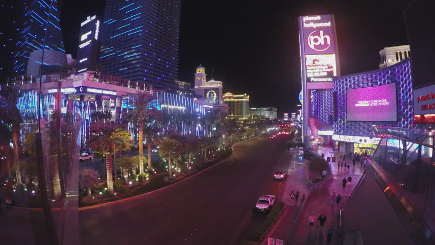 LAS VEGAS, NV/USA - June 27, 2015: Colorful casino lights on Las Vegas Boulevard from a high walkway at night. Signs, billboards, and other displays featuring neon and digital displays light the sky. | Shutterstock HD Video #11075672