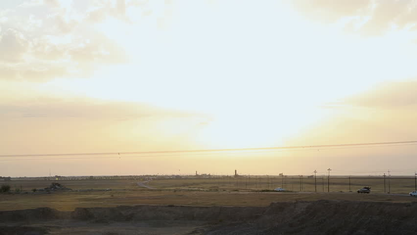 Cars heading to the city of Amerli in Iraq at sunset. Amerli steadfastness to the advancement of ISIS was a turning point in the war between Iraqi government and ISIS