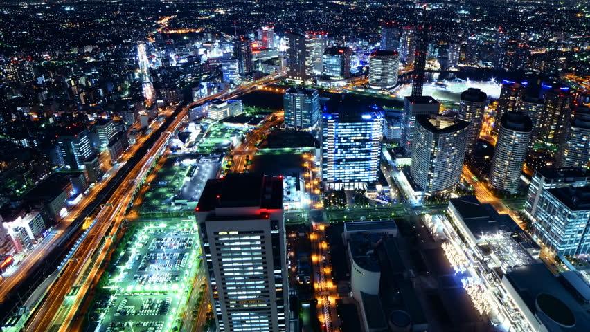 Time lapse footage of metropolitan cityscape at night shot from Yokohama Landmark Tower in Japan -Long Shot-
