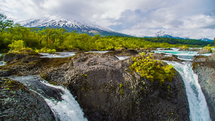 Cascades and waterfalls in Patagonia, Chile with Osorno Volcano in View | Shutterstock HD Video #11117387