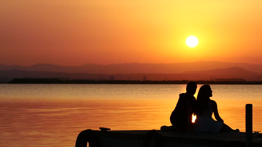 Dating backlit in a sunset in the Natural Park La Dehesa, Valencia, Spain. August 2015. - 4K stock video clip