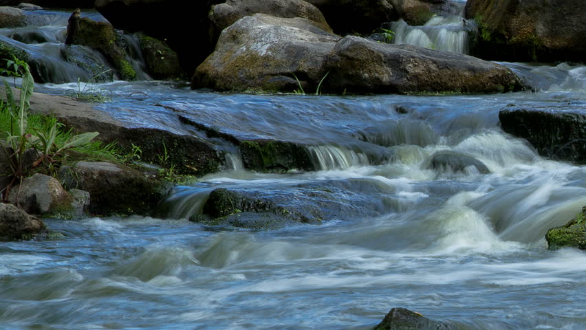 forest stream time lapse, Stream Water and Green Mossy Rocks, Moss On The Rocks Forest Stream, Forest river, Water runs quickly through the rapids, Granite boulders with river - HD stock video clip