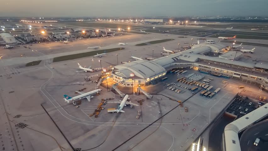 Timelapse of airport terminal sunset in aerial view with aircraft taxing and landing. | Shutterstock HD Video #11158940