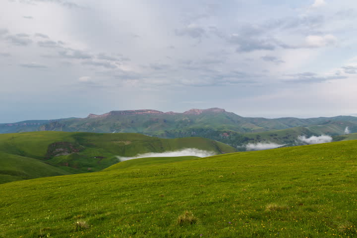 Time lapse 4K. Russia, the Caucasus Mountains, Kabardino-Balkaria. The formation of clouds over alpine meadows, storm clouds. | Shutterstock HD Video #11162909