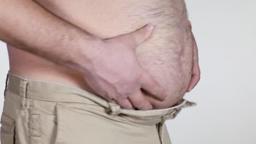 Fat man grabbing his big belly - HD stock footage clip