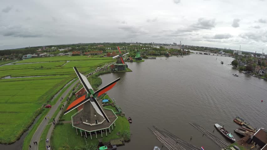 Zaandam Zaanse Schans aerial bird eye helicopter view of the windmills one of the most popular tourist attractions in Netherlands Holland exists of wooden windmills barns houses museum turning blades | Shutterstock HD Video #11232200