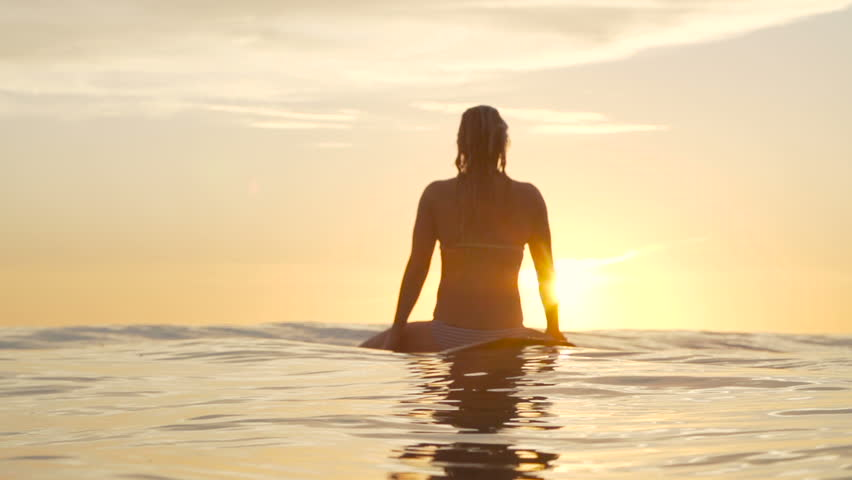 Surfer Girl Waiting for Wave At Sunset  - HD stock video clip