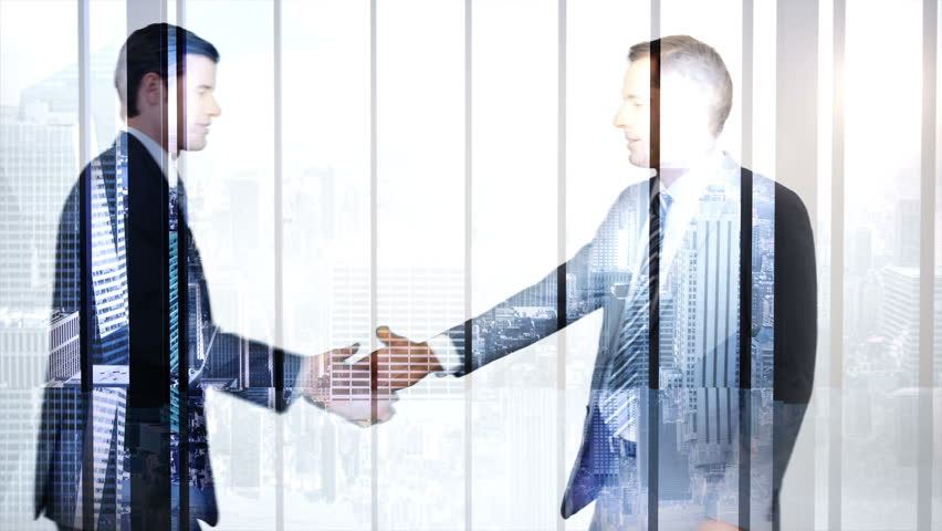 Digitally generated of business workers shaking hand with skyscraper overlay - HD stock footage clip