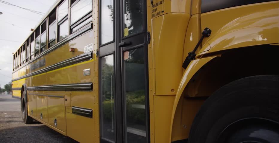 Children exiting the school bus | Shutterstock HD Video #11274554