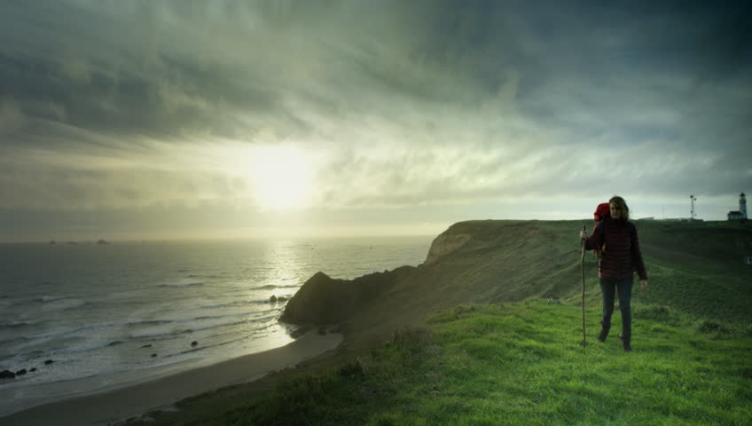 Woman hiking trail on cliffs on the Oregon Coast - 4K stock footage clip