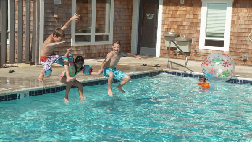 Kids jumping into pool in slow motion, shot on Phantom Flex 4K