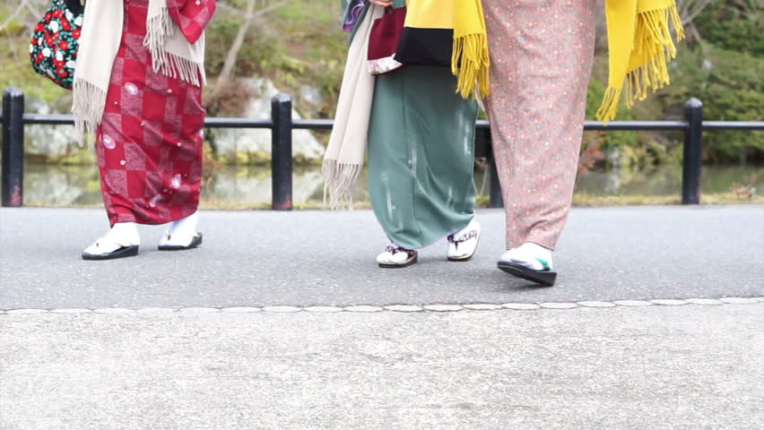 Brilliant On The Right In Orange  Is Wearing A Hakama  Kimono With Sandals