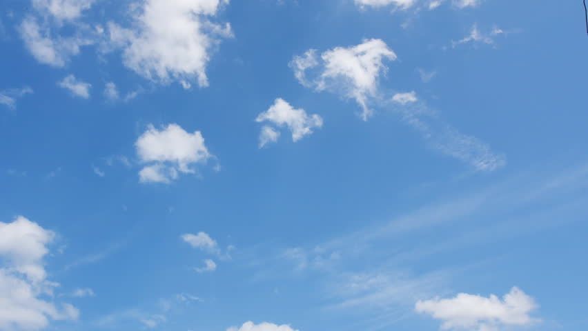Time lapse clip of white fluffy clouds over blue sky  - HD stock video clip