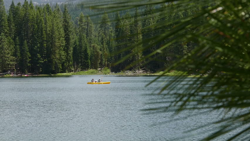 Lassen Volcanic National Park, California, United States of America  July, 2015: A family (father, mother, and child) paddle a kayak on Manzanita Lake.