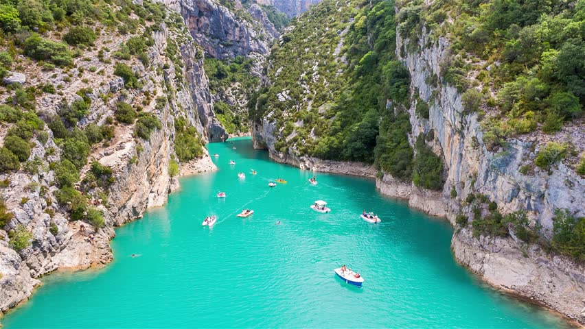 GORGES DU VERDON, FRANCE - AUGUST 15, 2015: People rowing and recreating in Verdon Gorge, on mouth of Le Verdon river, near Aiguines. Canyon is about 25 kilometres long and up to 700 metres deep. | Shutterstock HD Video #11372663