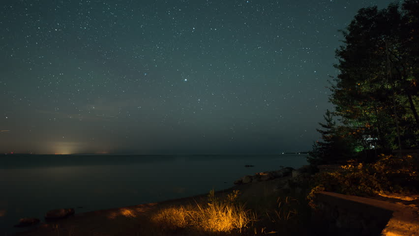 4K time lapse of stars and meteors over the water on a beach.  Note that because this is a time lapse sequence it can be used at any frame rate, 23.98, 24, 25, 30, 60, etc. without issue.