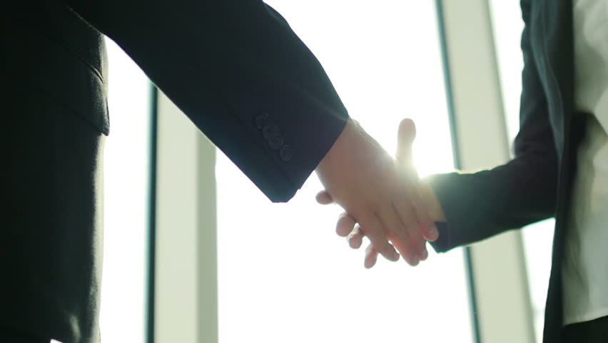 Two business partner shake hands when meeting. In slow motion | Shutterstock HD Video #11397458