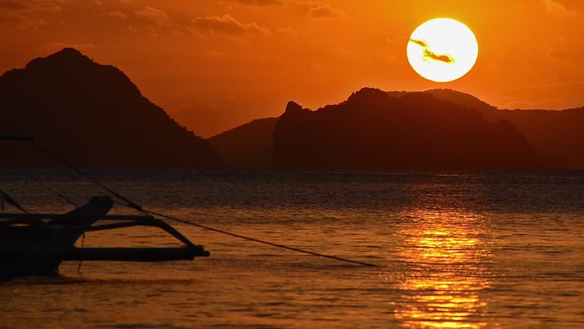 Beautiful sunset with silhouette of philippine boat in El Nido, Palawan island, Philippines