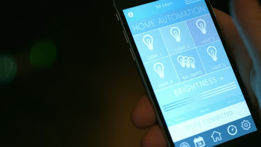 Smart Home technology - smart house, home automation, device with app icons. Man uses his smart phone with smart home app to turn on the lights in his house. IOT technology (Shot on RED) | Shutterstock HD Video #11408627