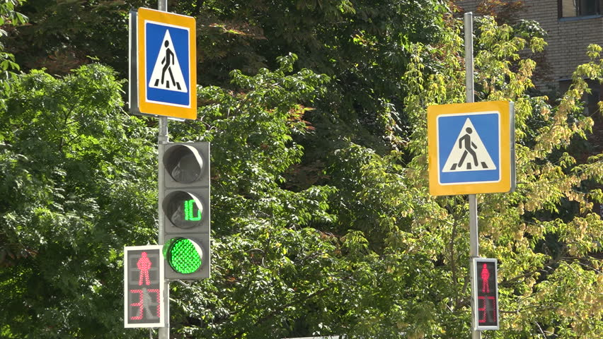 The switching signal of the traffic light. Road signs - HD stock footage clip