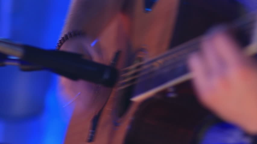 Close-up hands of a man playing the guitar during a concert. - HD stock video clip