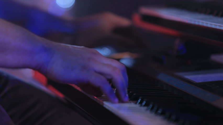 hands playing the piano - HD stock video clip