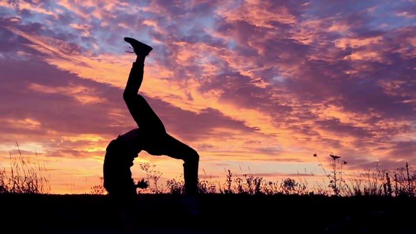 Girl doing acrobatic element at sunset. Slow motion. | Shutterstock HD Video #11462087