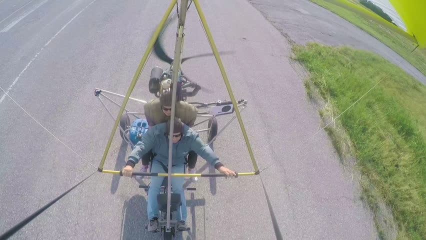 Hang Gliding tandem Take off flying above fields and forests. Hang Gliding as extreme and fun sport. | Shutterstock HD Video #11469008
